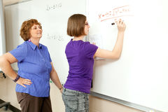 Stock Photo of Student and Teacher at Blackboard stock images