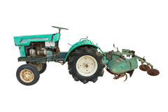 Stock Photo:surface level view of a nostalgic blue tractor isol Royalty Free Stock Photos
