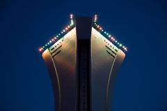 Stock Photo of the Top of the Montreal Olympic Stadium. A night image of the top of the Montreal Olympic Stadium illuminated by multi-colored lights royalty free stock photos