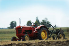 Stock photo of a tractor in a field. A tractor sits in a field Royalty Free Stock Photo