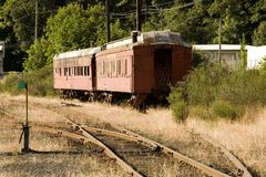 Stock Photo of Two Old Red Train Cars Stock Images