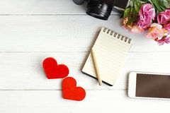 Stock Photo:Two Wooden hearts on a wooden background Royalty Free Stock Photo
