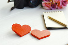 Stock Photo:Two Wooden hearts on a wooden background Royalty Free Stock Images