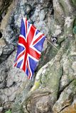 Stock Photo - United Kingdom flag embroidered on Hellfire Pass i. Peoples laid United Kingdom flag, bead necklace and the boomerang to commemorate POWs at Stock Image