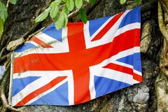 Stock Photo - United Kingdom flag embroidered on Hellfire Pass i. Peoples laid United Kingdom flag, bead necklace and the boomerang to commemorate POWs at Royalty Free Stock Photos