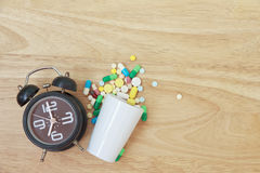 Stock Photo:Variety of colorful pills arranged in white medicat Stock Photo