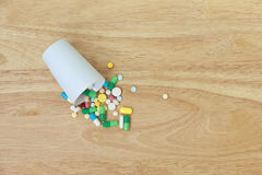 Stock Photo:Variety of colorful pills arranged in white medicat Stock Photos