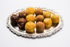Stock photo of collection of variety of sweets or orange peda or pedha or pera made up of milk, khoya, sugar , saffron etc. select Royalty Free Stock Photos