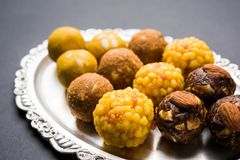 Stock photo of collection of variety of sweets or orange peda or pedha or pera made up of milk, khoya, sugar , saffron etc. select Stock Photography