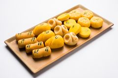 Stock photo of collection of variety of sweets or orange peda or pedha or pera made up of milk, khoya, sugar , saffron etc. select Stock Image