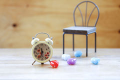 Stock Photo:Vintage background with retro alarm clock on table Stock Image