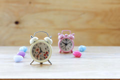 Stock Photo:Vintage background with retro alarm clock on table Royalty Free Stock Photos