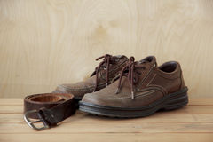 Stock Photo:Vintage,leather shoes on wood table Stock Photo
