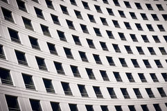 Windows on a curved building. A stock photo of a wall of windows on a building Royalty Free Stock Photos