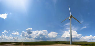 Stock Photo of windmill in blue sky. Stock Photo of windmill in blue sky with clouds Stock Photo