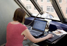 Stock Photo of a Woman Using Laptop Stock Photography