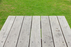 Stock Photo:Wood plank on natural green grass Stock Photography