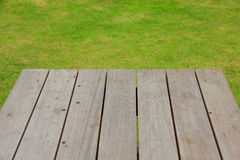 Stock Photo:Wood plank on natural green grass Royalty Free Stock Images