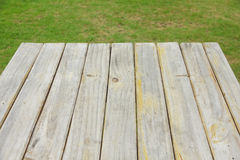 Stock Photo:Wood plank on natural green grass Stock Image