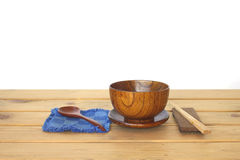 Stock Photo:Wooden bowl and wooden spoon on wooden table Royalty Free Stock Image