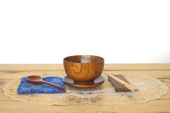 Stock Photo:Wooden bowl and wooden spoon on wooden table Stock Images
