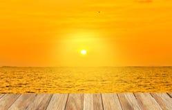 Stock Photo:Wooden platform beside tropical beach at sunset time Stock Photos