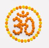 Stock photo of word Aum or om made using marigold flower arrangement Royalty Free Stock Photography