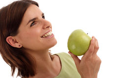 Stock photo of a young pretty woman. With green apple stock image