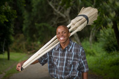Stock photograph of South African entrepreneur small business broom salesman Royalty Free Stock Photo