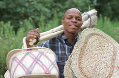Stock photograph of South African entrepreneur small business broom salesman Stock Photography