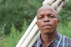 Stock photograph of a worried South African entrepreneur small business broom salesman stock image