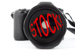 Stock photography. Selective focus on a camera lens with text 'Stock!' as a concept of microstock photography Stock Image