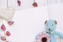 Stock Photography flat lay vintage white painted wood table purple flower petals bear doll heart craft royalty free stock images