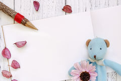 Stock Photography flat lay vintage white painted wood table purple flower petals bear doll pencil royalty free stock photography
