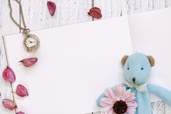 Stock Photography flat lay vintage white painted wood table purple flower petals bear doll pocket clock stock image