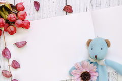 Stock Photography flat lay vintage white painted wood table purple flower petals bear doll rose royalty free stock images
