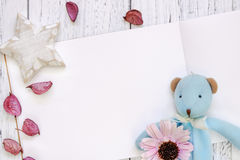 Stock Photography flat lay vintage white painted wood table purple flower petals bear doll star craft stock photo