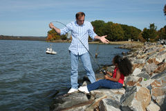 Stock Photography: Interracial Father Daughter Fishing royalty free stock images