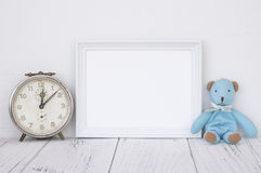 Stock photography white frame vintage painted wood table blue bear antique alarm clock. Stock photography white frame vintage painted wood table cute blue bear royalty free stock image