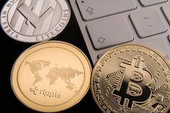 Stock of physical bitcoins, btc, bitcoin, ripple, ethereum, litecoins, gold and silver coins, cryptocurrency concept royalty free stock photography