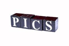 Stock pics. Pics spelled on black blocks royalty free stock photography