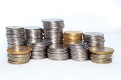 Stock pile of Hundred number 1, 10, 5 Indian rupee metal coin currency on isolated background. Financial, economy, investment stock photography