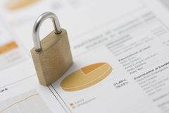 Stock portfolio and closed padlock Stock Images