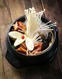 Stock pot on a stove with vegetables enokitake and beef Stock Images
