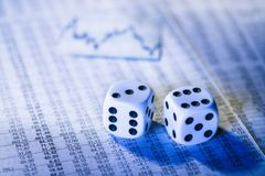 Stock prices and dice Stock Photos