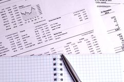 Stock quotes and charts on paper stock photos