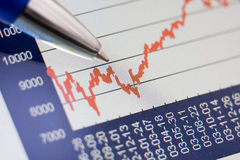 Stock rates chart. Pen points to stock rates, financial crisis royalty free stock image