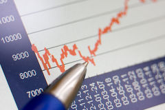 Stock rates chart. Pen points to stock rates, financial crisis stock photo