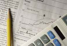 Stock Research. Photo of Newspaper, Pencil and Calculator - Part of Series stock image