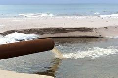 Stock, sea, pipe, draining, ecology, sanitation, pollution. Stock sea pipe draining ecology sanitation pollution Stock Photography